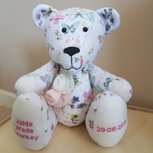 Keepsake Memory Bear - Image of a keepsake bear, with floral patterned fabric and embroidery on the feet.