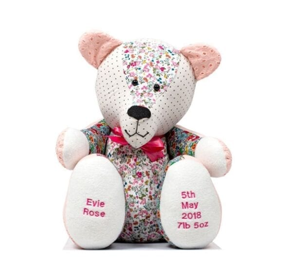 Keepsake Memory Bear - Image of a keepsake memory bear, made from a white plain fabric and a pink floral fabric, with a bow tie at the neck and embroidery on the feet.