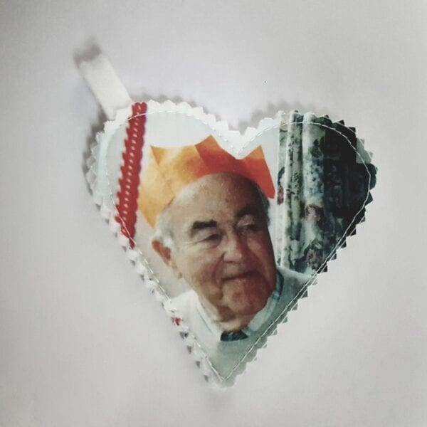 Photo Memory Bear - Image of a small fabric heart with a photo of an elderly man printed on it.