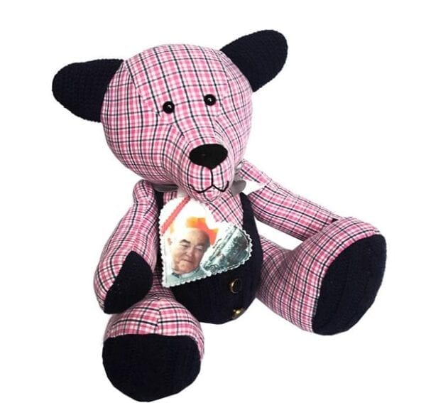 Photo Memory Bear - Image of a photo keepsake memory bear, made from a red and blue check fabric, wearing a fabric photo heart around the neck.