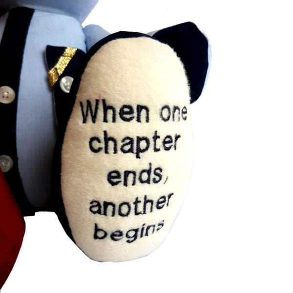 Uniform Memory Bear - Close up image of an embroidered message on the bear's foot.