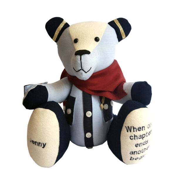 Uniform Memory Bear - Image of a keepsake bear made from an old airline uniform, with a silky red scarf around the neck.