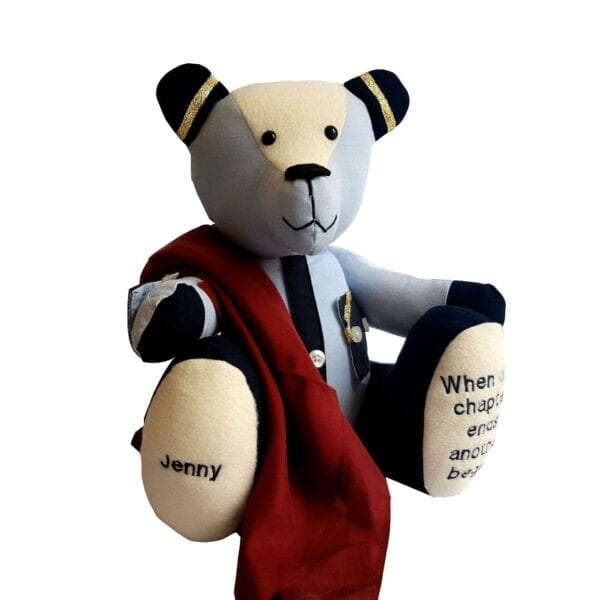 Uniform Memory Bear - Image of a keepsake bear made from an old airline uniform, with a silky red scarf draped around the body.