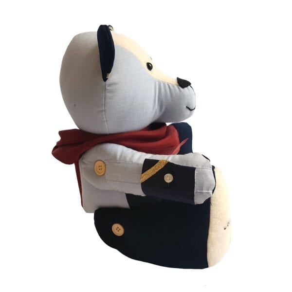 Uniform Memory Bear - Side view image of a keepsake bear made from an old airline uniform, with a silky red scarf around the neck.