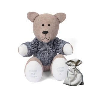 Ashes Memory Bear - Image of a keepsake memory bear made from beige coloured fabric, with embroidered feet, an ashes pouch and grey knitted jumper.