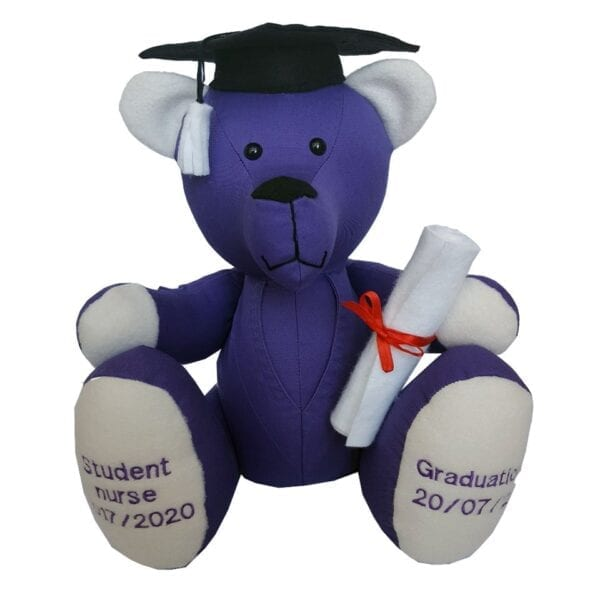 Graduation Memory Bear - Image of a keepsake memory bear, made from a purple student nurse uniform, with embroidered feet, wearing a black mortarboard hat and holding a scroll.