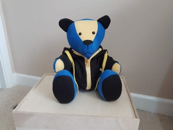 Memorial Memory Bear - Image of a keepsake bear made from a yellow and purple fabric and a black hoodie.