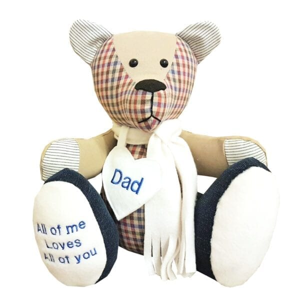 Memorial Memory Bear - Image of a keepsake memory bear, made from a red and beige check fabric, wearing a scarf and a personalised heart around the neck.