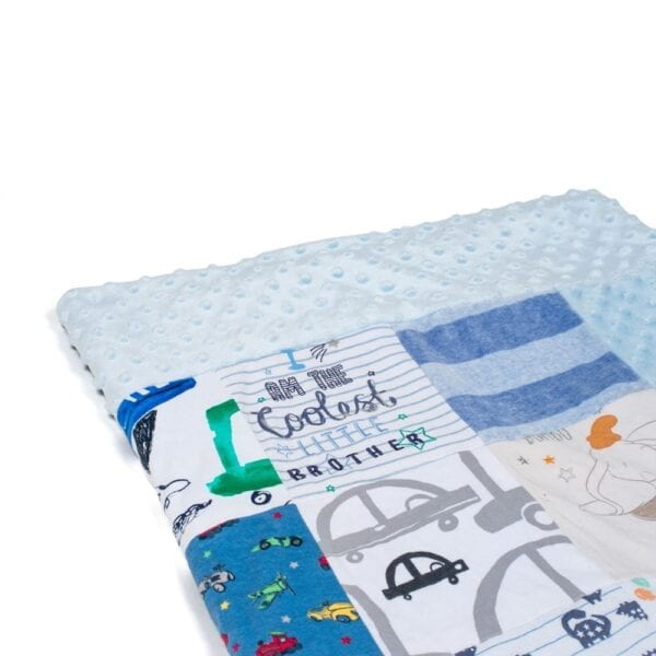 Bobble Memory Blanket: Image of a folded blue bobble blanket made from baby clothes.
