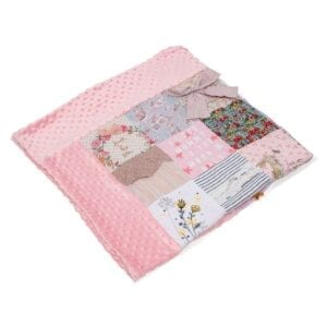Bobble Memory Blanket: Image of a folded pink bobble fleece blanket, made from baby clothes.