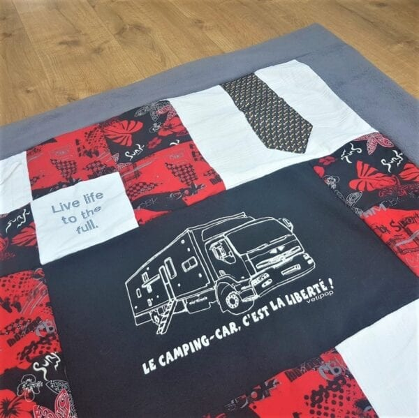 Fleece Memory Blanket: Image of a section of a grey fleece blanket made from adult clothes.
