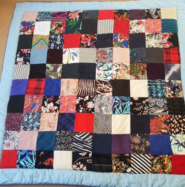 Luxury Memory Quilt: Image of a large patchwork quilt laid out flat.